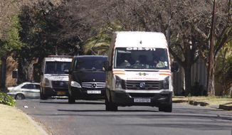 An ambulance transporting former South African President Nelson Mandela arrives at his home in Johannesburg on Sunday, Sept. 1, 2013. Mr. Mandela was hospitalized for almost three months fighting a recurring lung infection. (AP Photo/Denis Farrell)