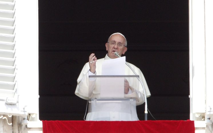 Pope Francis recites the Angelus prayer from his studio window overlooking St. Peter's Square at the Vatican on Sunday, Sept. 1, 2013. The pontiff is asking people to join him next weekend in a day of fasting for peace in Syria. (AP Photo/Riccardo De Luca)