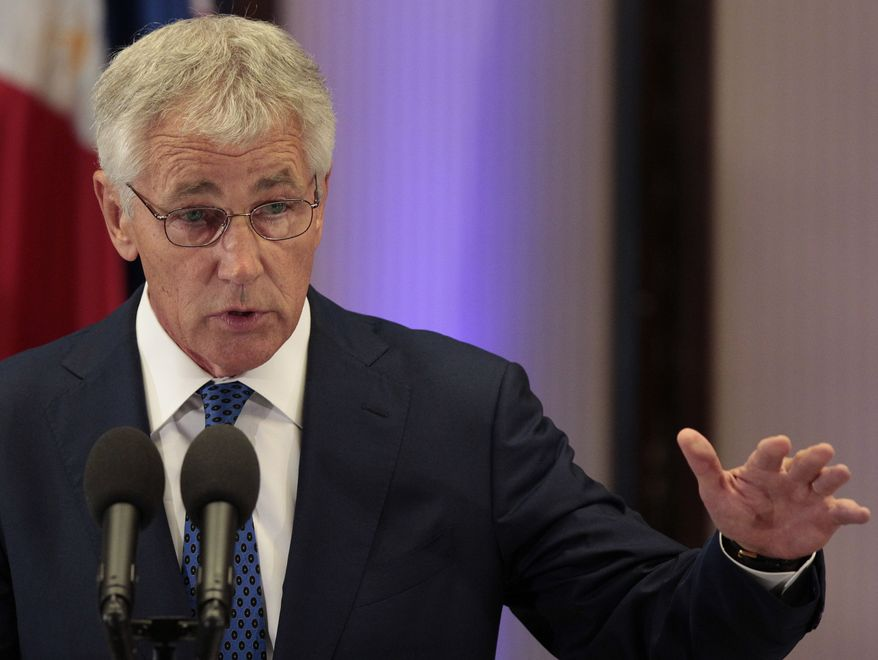 Defense Secretary Chuck Hagel answers questions from reporters during his visit at the Malacanang Palace in Manila on Friday, Aug. 30, 2013. (AP Photo/Aaron Favila)