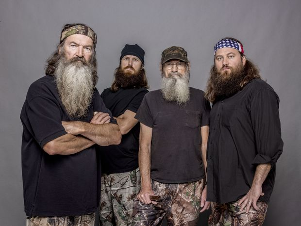 """Members of the """"Duck Dynasty"""" clan include (from left) Phil Robertson, Jase Robertson, Si Robertson and Willie Robertson. (AP Photo/A&E, Zach Dilgard)"""