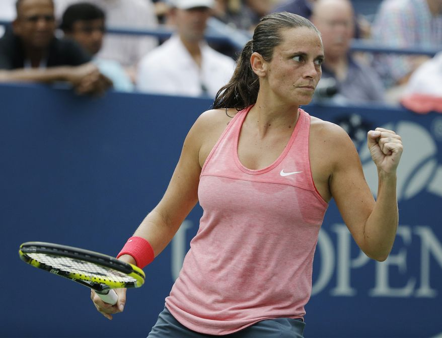 Roberta Vinci, of Italy, reacts after a point against Camila Giorgi, of Italy, during the fourth round of the 2013 U.S. Open tennis tournament, Monday, Sept. 2, 2013, in New York. (AP Photo/David Goldman)