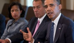 President Obama met with National Security Adviser Susan E. Rice (left) and House Speaker John A. Boehner, Ohio Republican, in the Cabinet Room of the White House on Tuesday before meeting with members of Congress to discuss Syria and a proposed military strike. (ASSOCIATED PRESS)