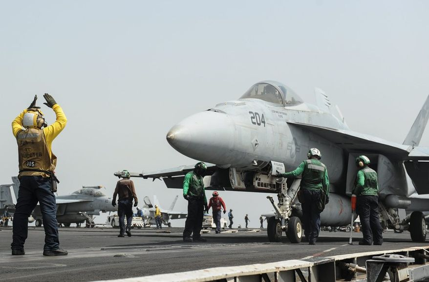 Ready: A Super Hornet is prepared to launch from the USS Nimitz. The carrier was scheduled to return home but was ordered to stay in the Red Sea. (U.S. Navy via associated press)