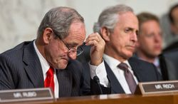 "Sen. James E. Risch, Idaho Republican (left) and Sen. Bob Corker, Tennessee Republican, listen to testimony from Secretary of State John F. Kerry. Mr. Risch said that he was reluctant partly because of ""where this is going to go, as to the limit that we're going to put on it."""