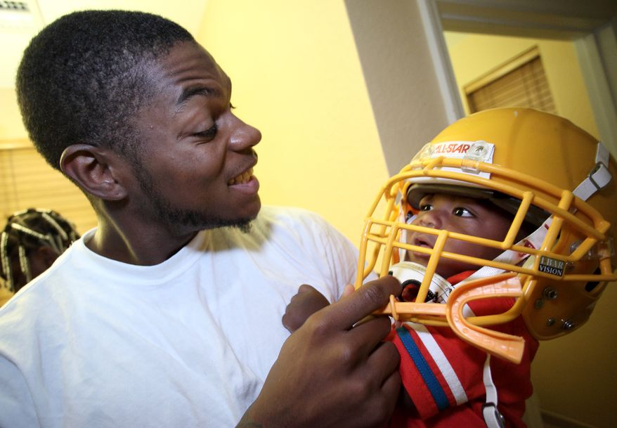 Washington Redskins wide receiver Leonard Hankerson plays with his 11 month-old son Lenaris at their home in Lauderhill, Florida on July 18, 2013. (Cristobal Herrera/For The Washington Times)