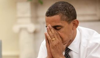 President Obama reacts during an Oval Office meeting in this file photo. (White House photo/Pete Souza) ** FILE **