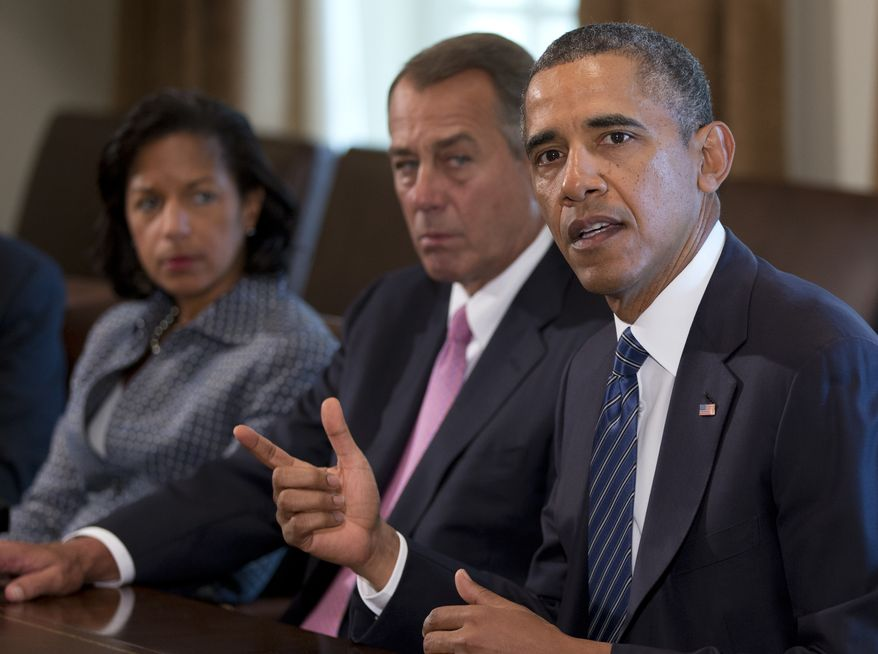 President Obama speaks to the press as National Security Adviser Susan Rice (left) and House Speaker John Boehner, Ohio Republican, look to him in the Cabinet Room of the White House in Washington on Sept. 3, 2013, before a meeting with members of Congress to discuss the situation in Syria. (Associated Press)