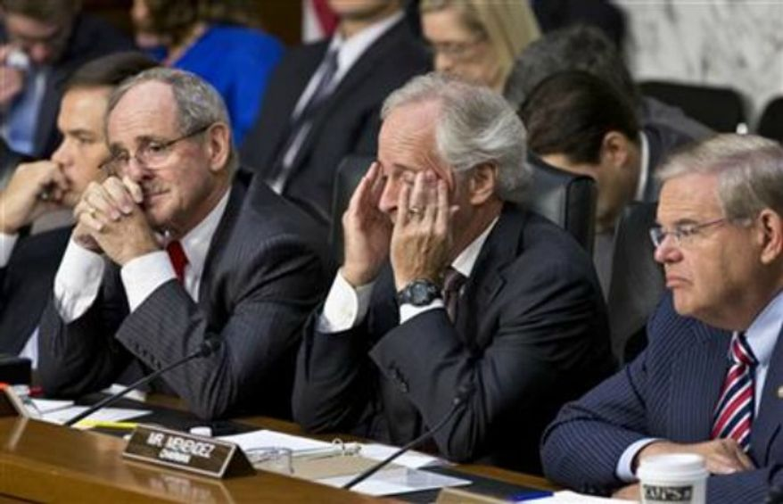 From right to left, Senate Foreign Relations Chairman Robert Menendez, D-N.J., Sen. Bob Corker, R-Tenn., the ranking member, Sen. James Risch, R-Idaho, and Sen. Marco Rubio, R-Fla., listen to testimony from Secretary of State John Kerry, and Defense Secretary Chuck Hagel at a hearing on President Obama's request for congressional authorization for military intervention in Syria, a response to last month's alleged sarin gas attack in the Syrian civil war, on Capitol Hill in Washington, Tuesday, Sept. 3, 2013. (AP Photo/J. Scott Applewhite)