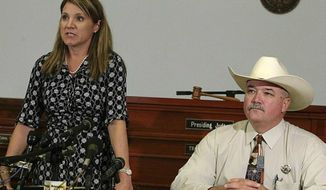 ** FILE ** 25th Judicial District Attorney Heather McMinn, left, and Lavaca County Sheriff Mica Harmon appear at a news conference in Halletsville, Texas on June 19, 2012. (Associated Press)