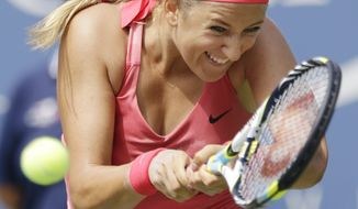 Victoria Azarenka, of Belarus, returns a shot to Ana Ivanovic, of Serbia, during the quarterfinals of the 2013 U.S. Open tennis tournament, Tuesday, Sept. 3, 2013, in New York. (AP Photo/Julio Cortez)