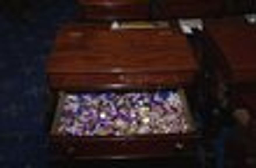 The candy desk, which consistently needs the most maintenance, stands in the back row on the Republican side, close to the most heavily used entrance to the Senate chamber. (senate.gov PHOTOGRAPHS)