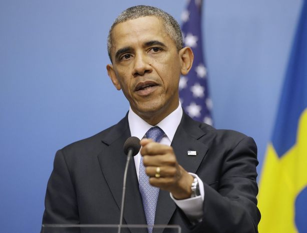 """""""The international community's credibility is on the line"""" with Syria, President Obama says during a news conference in Stockholm on Wednesday, a day before traveling to Russia for a Group of 20 summit. (Associated Press)"""