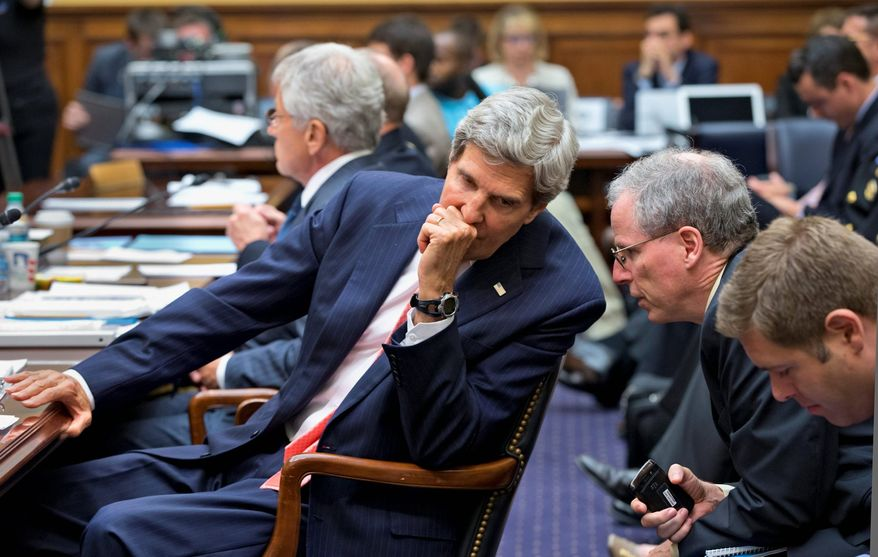 Secretary of State John F. Kerry confers with U.S. Ambassador to Syria Robert Ford on Capitol Hill on Wednesday during a House Foreign Affairs Committee hearing on President Obama's request for congressional authorization for military intervention in Syria. The assault would be a response to a chemical weapons attack in the Syrian civil war. (Associated Press)