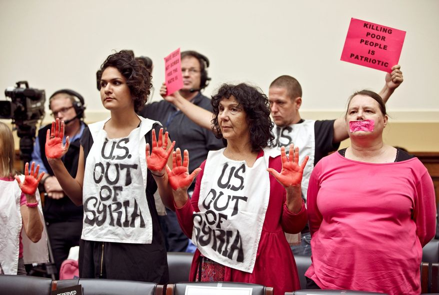 Code Pink protesters bring their anti-war message to the Capitol before Wednesday's House hearing on President Obama's request for military intervention in Syria. (Associated Press)