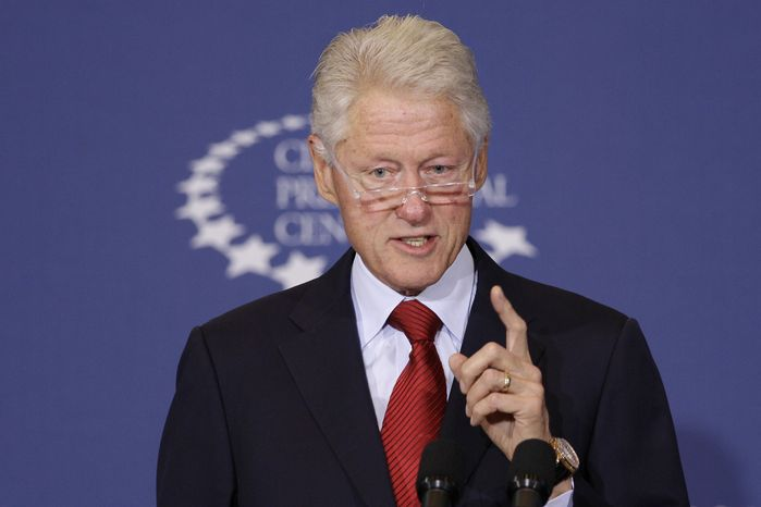 ** FILE ** Former President Bill Clinton speaks about health care at the Clinton Presidential Center in Little Rock, Ark., on Wednesday, Sept. 4, 2013. (AP Photo/Danny Johnston)