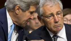 Secretary of State John Kerry, left, talks to Defense Secretary Chuck Hagel on Capitol Hill in Washington, Tuesday, Sept. 3, 2013, prior to the start of the Senate Foreign Relations Committee hearing on Syria where they testified. (AP Photo/Jacquelyn Martin)