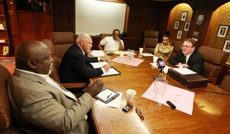 The leadership of the NAACP Casper branch speak with John Abarr, far right, a kleagle of the United Klans of America out of Great Falls, Mont., on Saturday night, Aug. 31, 2013, at the Parkway Plaza hotel in Casper, Wyo. Jimmy Simmons, president of the NAACP Casper branch, spent several months attempting to organize the meeting due to concerns about reports of violence against black men and Ku Klux Klan pamphleting in Gillette, Wyo. (AP Photo/Casper Star-Tribune, Alan Rogers) **FILE**