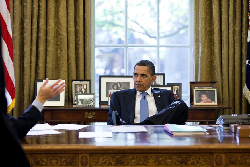 President Barack Obama listens to an aide during a meeting in the Oval Office, Nov. 7, 2009. (Official White House Photo by Pete Souza)