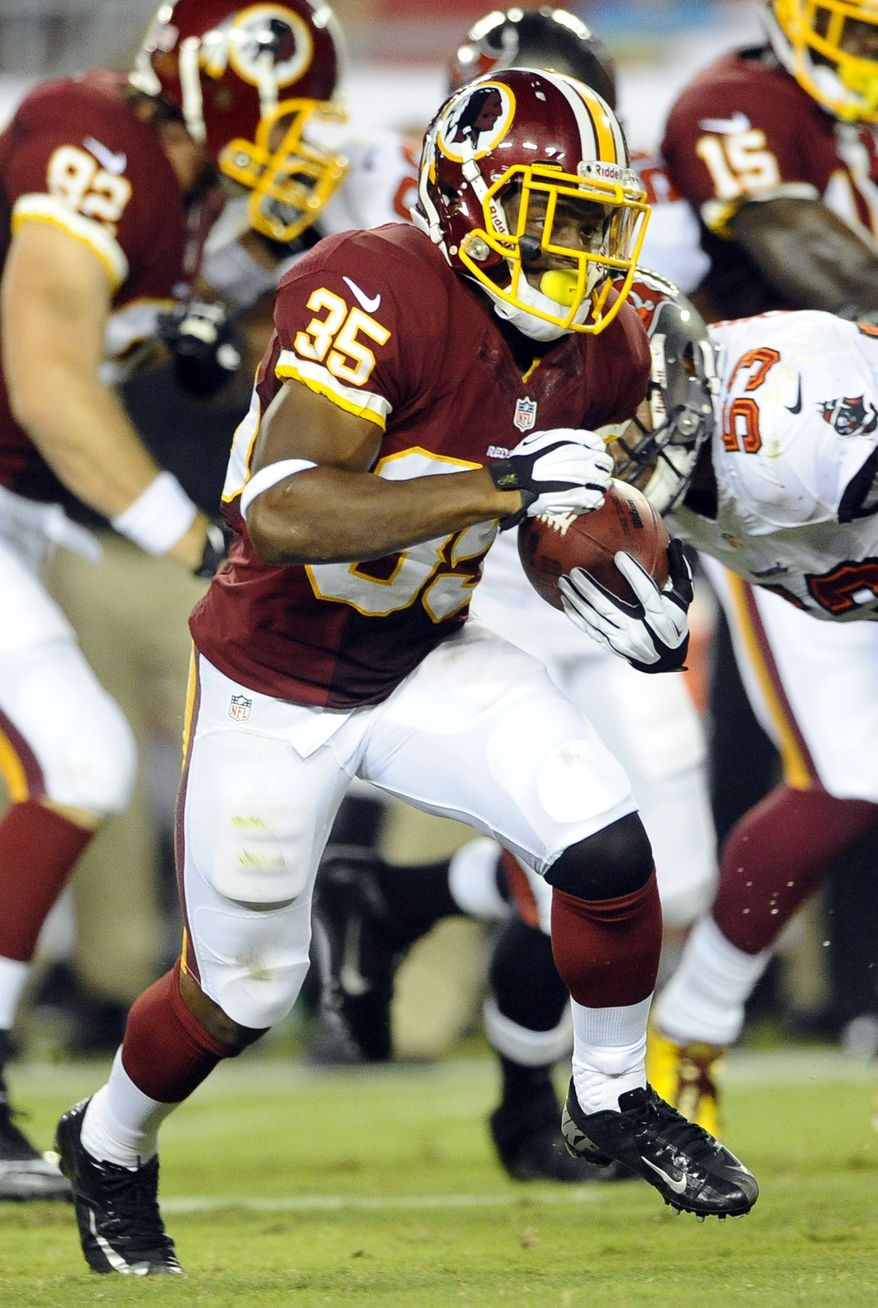 Washington Redskins running back Chris Thompson runs against the Tampa Bay Buccaneers during the first half of an NFL preseason football game Thursday, Aug. 29, 2013, in Tampa, Fla. (AP Photo/Brian Blanco)