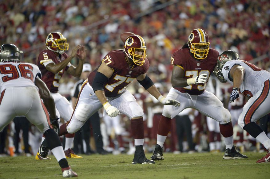 Washington Redskins tackle Tony Pashos (77) and guard Adam Gettis (73) block for quarterback Pat White (5) against Tampa Bay Buccaneers defensive end Steven Means (96) and defensive end Matthew Masifilo (65), right, during the first half of a preseason NFL football game in Tampa, Fla., Thursday, Aug. 29, 2013.(AP Photo/Phelan M. Ebenhack)