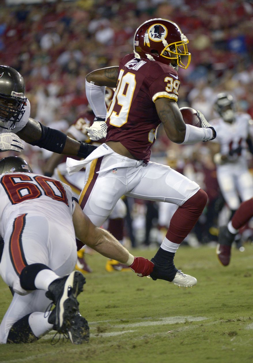 Washington Redskins cornerback David Amerson (39) runs past Tampa Bay Buccaneers tackle Mike Remmers (60) after making an interception during the first half of a preseason NFL football game in Tampa, Fla., Thursday, Aug. 29, 2013.(AP Photo/Phelan M. Ebenhack)