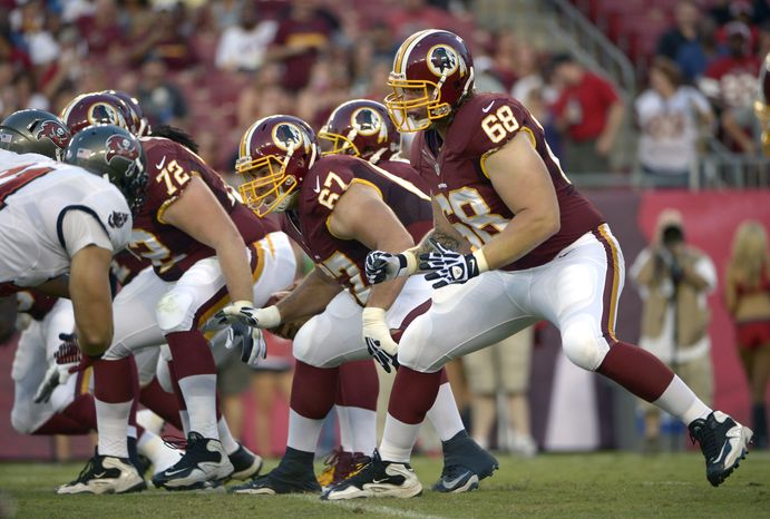 Washington Redskins guard Josh LeRibeus (67) and tackle Tom Compton (68) set up to block during the first half of a preseason NFL football game against the Tampa Bay Buccaneers in Tampa, Fla., Thursday, Aug. 29, 2013.(AP Photo/Phelan M. Ebenhack)