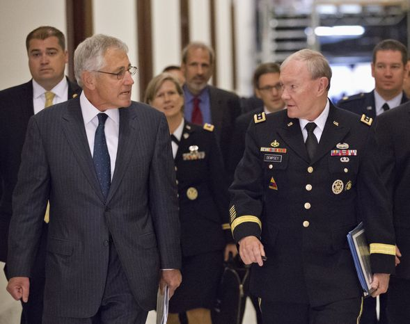 ** FILE ** Defense Secretary Chuck Hagel (left) and Army Gen. Martin E. Dempsey (right), chairman of the Joint Chiefs of Staff, arrive for a closed-door intelligence briefing for members of the Senate Armed Services Committee on Capitol Hill in Washington on Wednesday, Sept. 4, 2013. (AP Photo/J. Scott Applewhite)