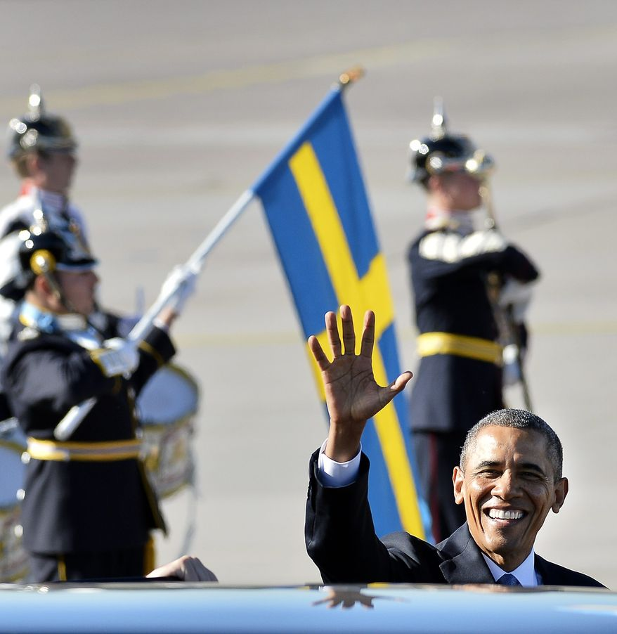 U.S. President Barack Obama waves upon arrival at Arlanda Airport, in Stockholm, Sweden, Wednesday, Sept. 4, 2013, with the Swedish flag and guard of honor in the background. President Barack Obama is opening a three-day overseas trip with a stop in the Swedish capital of Stockholm. Air Force One touched down Wednesday morning after an overnight flight from Washington. During his stay in Stockholm, Obama will meet with Swedish Prime Minister Fredrik Reinfeldt and King Carl XVI Gustaf. He will also meet with other Nordic leaders from Finland, Denmark, Iceland and Norway. (AP Photo/Scanpix Sweden, Anders Wiklund)