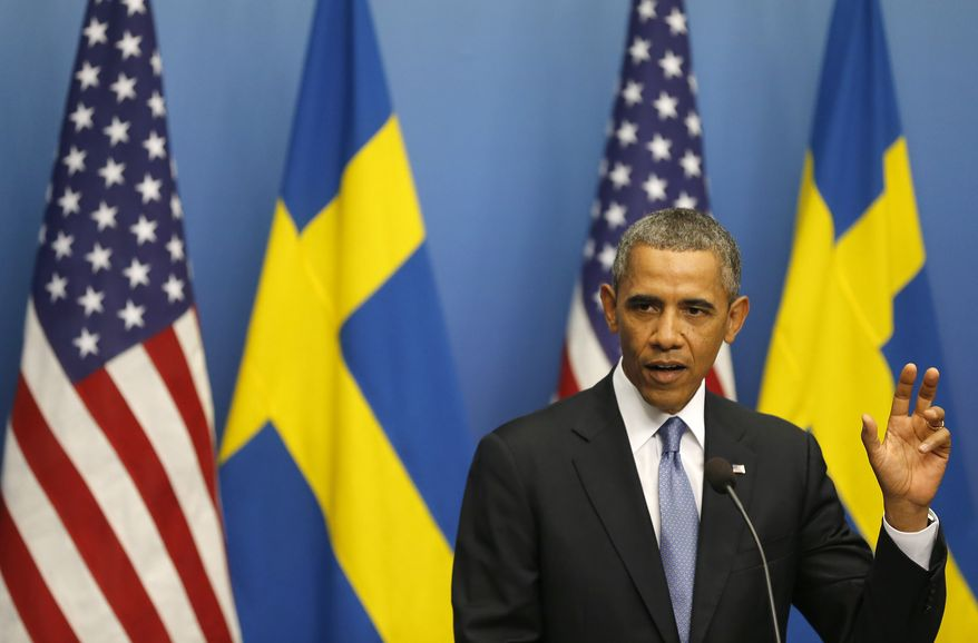 President Obama gestures during a press conference at Rosenbad, the seat of the Swedish government, in Stockholm on Wednesday, Sept. 4, 2013. Mr. Obama is on a visit to Sweden ahead of the G-20 summit in St. Petersburg. (AP Photo/Frank Augstein)
