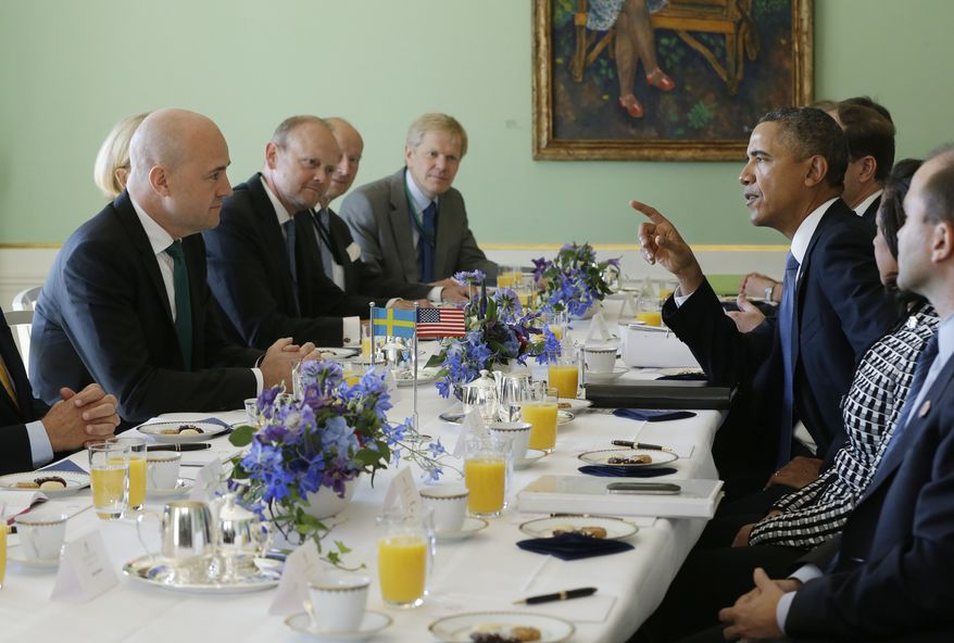 U.S. President Barack Obama, right, and Swedish Prime Minister Fredrik Reinfeldt, left, converse during their bilateral meeting at the Rosenbad Building, Wednesday, Sept. 4, 2013, in Stockholm, Sweden. (AP Photo/Pablo Martinez Monsivais)