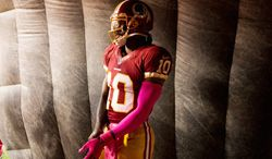 """""""The goal is longevity in the league,"""" Redskins quarterback Robert Griffin III says. """"You also want to win. I think I proved how tough I am and the heart that I have on the football field and my teammates know that."""" (Andrew Harnik/The Washington Times)"""
