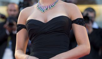 """Actress Scarlett Johansson poses for photographers on the red carpet for the screening of the film """"Under The Skin"""" at the 70th edition of the Venice Film Festival held from Aug. 28 through Sept. 7, in Venice, Italy, Tuesday, Sept. 3, 2013. (AP Photo/Andrew Medichini)"""