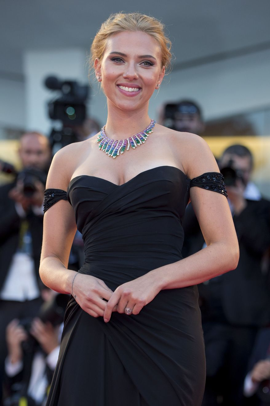 "Actress Scarlett Johansson poses for photographers on the red carpet for the screening of the film ""Under The Skin"" at the 70th edition of the Venice Film Festival held from Aug. 28 through Sept. 7, in Venice, Italy, Tuesday, Sept. 3, 2013. (AP Photo/Andrew Medichini)"
