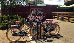 This June 2013 photo provided by Routes Bicycle Rentals & Tours shows bikes parked outside of Il Vicino Canteen in Albuquerque, N.M., on a brewery tour. Bike tours that take beer-lovers to visit craft breweries are offered around the country, ranging from tours that last several hours to more challenging trips that unfold over several days. Tour companies have also come up with a variety of strategies to prevent biking under the influence, including limiting swigs and providing back-up vans. (AP Photo/Routes Bicycle Rentals & Tours, Heather Wess Arnold) (Routes Bicycle Rentals & Tours via Associated Press)
