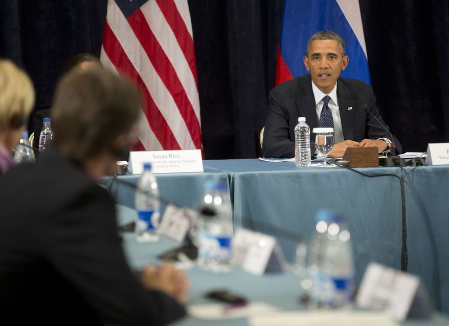 """President Barack Obama participates in a """"Civil Society Roundtable,"""" Friday, Sept. 6, 2013, in St. Petersburg, Russia. At left is Igor Kochetkov chairman of the Russian LGBT Network. (AP Photo/Pablo Martinez Monsivais)"""