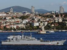 A Russian warship sails through the Bosporus in Istanbul, Turkey, on Sept. 5, 2013. A group of Russians warships are en route to the East Mediterranean. (Associated Press)
