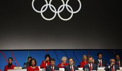 Spain's delegation attends the IOC session during the Madrid 2020 bid presentation at2wl;d the 125th International Olympic Committee session in  Buenos Aires, Argentina, Saturday, Sept. 7, 2013. Madrid, Istanbul and Tokyo are competing to host the 2020 Summer Olympic Games. (AP Photo/Natacha Pisarenko)