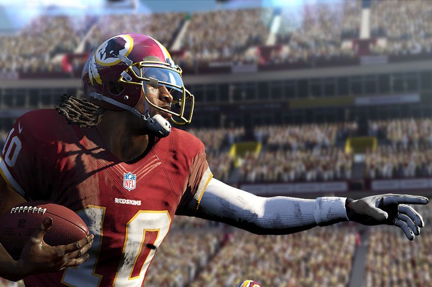 Washington Redskins' quarterback Robert Griffin III directs his offense in the video game Madden NFL 25.
