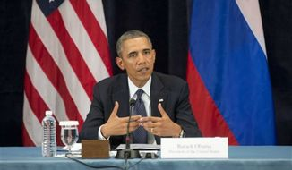 """President Obama gestures while speaking during a """"Civil Society Roundtable"""" with gay, lesbian, bisexual and transgender activists, Friday, Sept. 6, 2013, in St. Petersburg, Russia. (AP Photo/Pablo Martinez Monsivais)"""