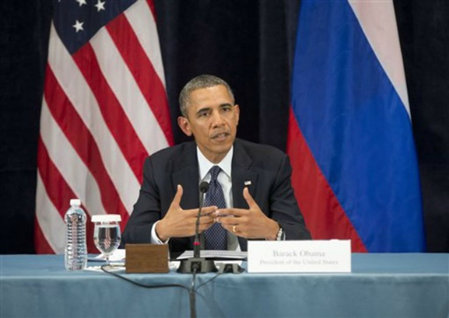 "President Obama gestures while speaking during a ""Civil Society Roundtable"" with gay, lesbian, bisexual and transgender activists, Friday, Sept. 6, 2013, in St. Petersburg, Russia. (AP Photo/Pablo Martinez Monsivais)"
