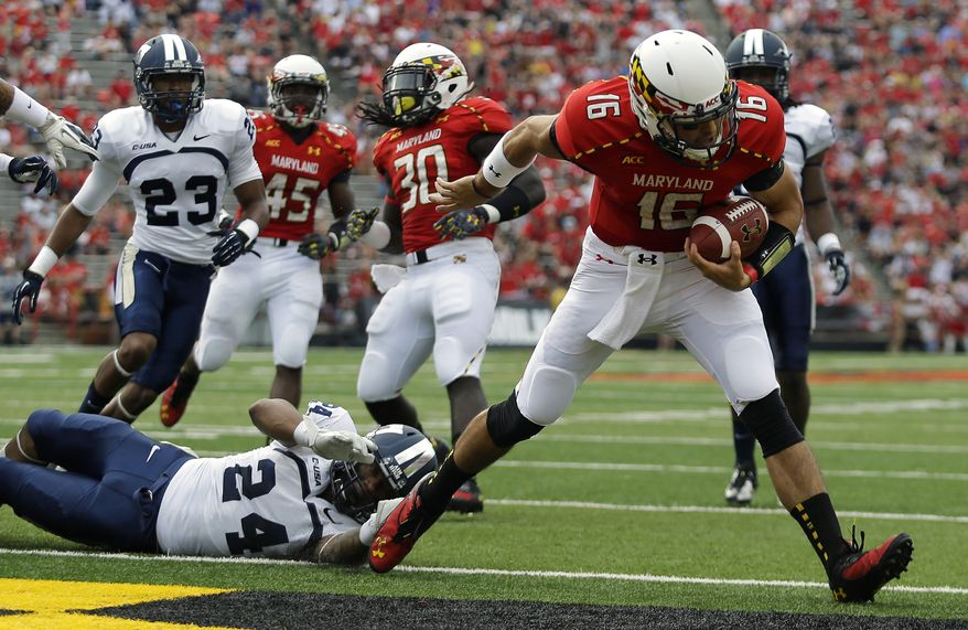 Maryland quarterback C.J. Brown (16) runs into the end zone past Old Dominion safety Fellonte Misher (24) for a touchdown in the first half of an NCAA college football game in College Park, Md., Saturday, Sept. 7, 2013. (AP Photo/Patrick Semansky)