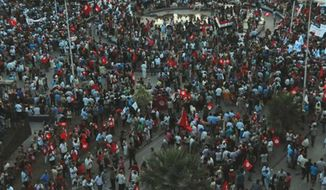 People demonstrate against Tunisia's Islamist-led government, in front of the Constituent Assembly headquarters in Tunis, Tunisia, Saturday Sept. 7, 2013. (AP Photo/Hassene Didri)