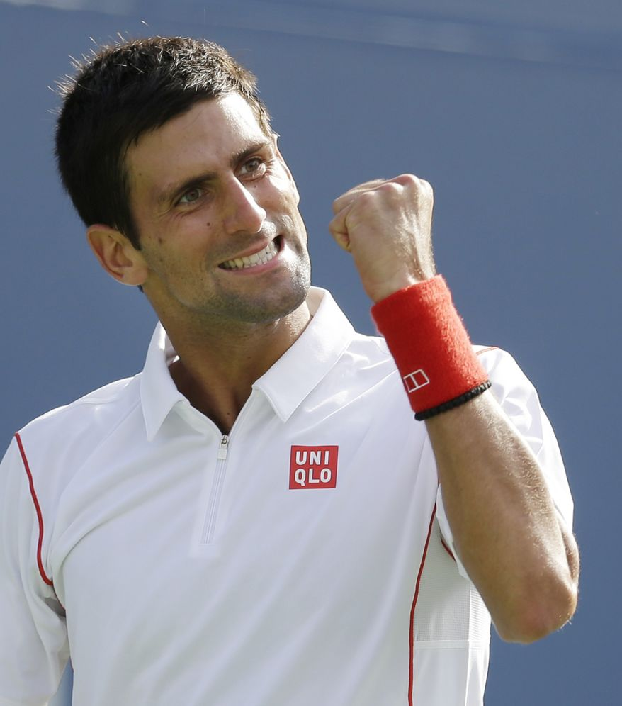 Novak Djokovic, of Serbia, reacts after winning a point against Stanislas Wawrinka, of Switzerland, during the semifinals of the 2013 U.S. Open tennis tournament, Saturday, Sept. 7, 2013, in New York. (AP Photo/Darron Cummings)