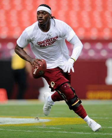 Quarterback Robert Griffin III will wear a brace on his reconstructed knee Monday night as the Washington Redskins open their season against the Philadelphia Eagles. (Associated Press)