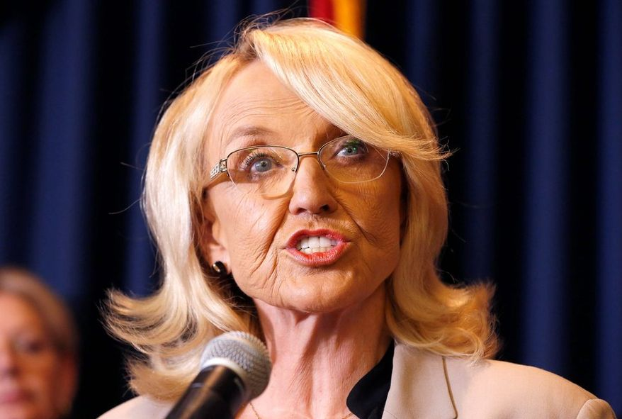 """Arizona Gov. Jan Brewer, in pressing for more federal assistance, said at least 17 homeowners proved that they are underinsured, and that """"this number certainly will increase"""" as homeowners realize their insurance policies do not cover their losses from fire. (ASSOCIATED PRESS PHOTOGRAPHS)"""