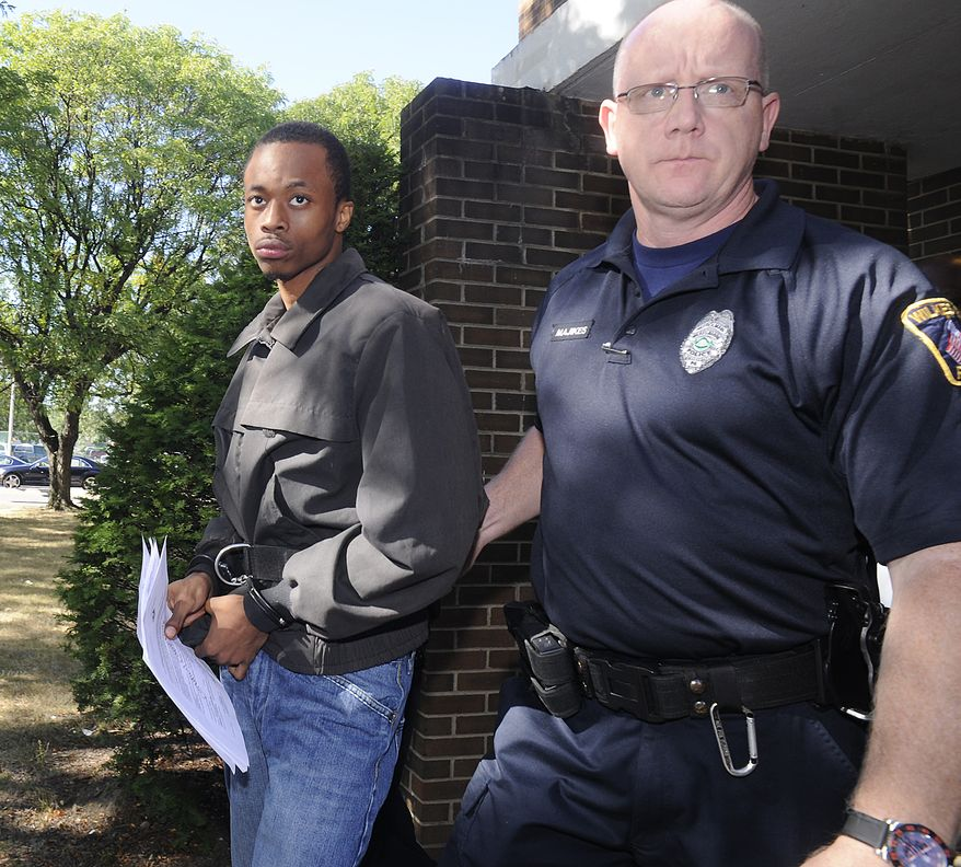 Dequan Breland (left) is led from a hearing in Wilkes-Barre, Pa., on Friday, Sept. 6, 2013, after being arrested in connection with the death of a New York City toddler shot in his stroller, according to authorities. Police located Mr. Breland, 23, and Dequan Wright, 19, at an apartment complex in Wilkes-Barre and arrested them without incident. (AP Photo/The Citizens' Voice, Mark Moran)