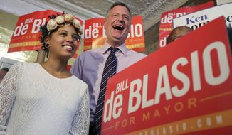 Democratic mayoral hopeful Bill de Blasio, with his daughter, Chiara, campaigns at a rally in the Brooklyn borough of New York on Saturday, Sept. 7, 2013. The Democratic primary election is Tuesday. (AP Photo/Mary Altaffer)