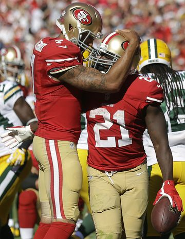 San Francisco 49ers running back Frank Gore (21) celebrates after scoring on a one-yard touchdown run with quarterback Colin Kaepernick during the fourth quarter of an NFL foo