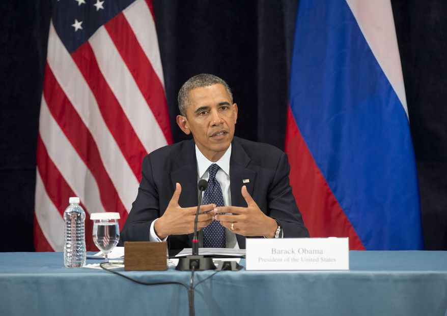 President Obama gestures while speaking during a Civil Society Roundtable with Russian gay, lesbian, bisexual and transgender activists on Friday, Sept. 6, 2013, in St. Petersburg. (AP Photo/Pablo Martinez Monsivais)