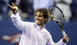 Rafael Nadal, of Spain, hits autographed balls to fans after beating Richard Gasquet, of France, during the semifinals of the 2013 U.S. Open tennis tournament, Saturday, Sept. 7, 2013, in New York. (AP Photo/Charles Krupa)